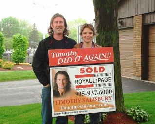 timothy-and-laura-with-sold-sign.jpg