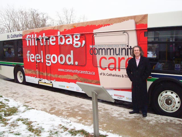 Timothy in front of St. Catharines Transit bus in 2011